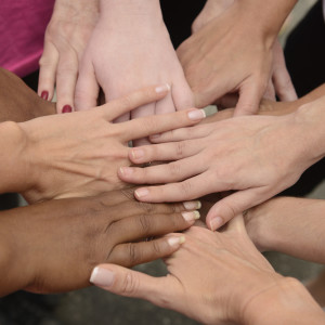 teamwork, group of women putting hands together